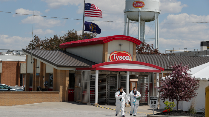In this May 7 photo, workers leave the Tyson Foods pork processing plant in Logansport, IN.